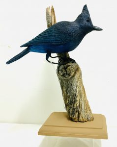Large Carved Blue Jay Perched on a Limb with a Wood Base