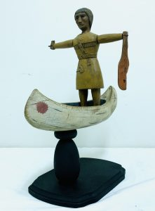 Carved Whirligig with Native American Standing in Canoe