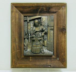 "Signed Wall Casting of ""Old Blacksmith"" by ""B. Forni""."
