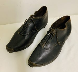 Pair of Early Larger Size Leather, Wood, Iron and Brass Shoes